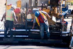 Crew working on DOT FHWA road construction project