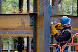 construction worker welding building beam