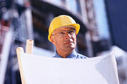 Construction engineer reviewing plans