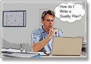man sitting at a computer writing a construction quality control plan