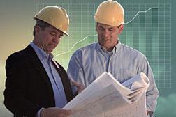 construction men reading plans