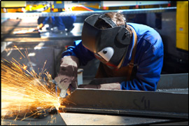 Welder working on steel fabrication