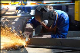 Welder working on steel fabrication